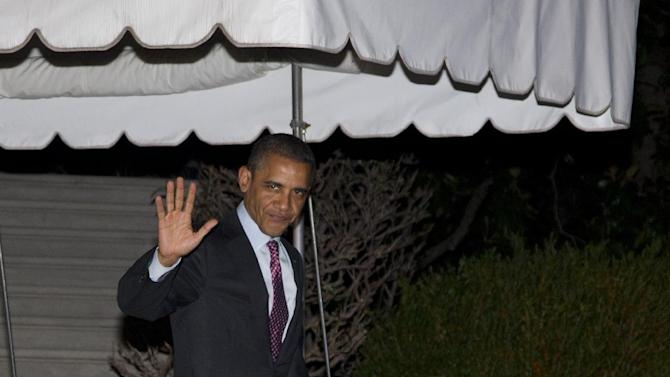 President Barack Obama waves to media as he walks from the White House to board Marine One, Friday, March 23, 2012, in Washington, as he travels to Seoul, Republic of Korea. (AP Photo/Carolyn Kaster)