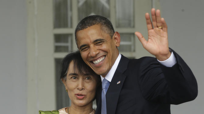 U.S. President Barack Obama, right, waves as he embraces Myanmar democracy activist Aung San Suu Kyi after addressing members of the media at Suu Kyi's residence in Yangon, Myanmar, Monday, Nov. 19, 2012. Obama touched down Monday morning, becoming the first U.S. president to visit the Asian nation also known as Burma. (AP Photo/Pablo Martinez Monsivais)