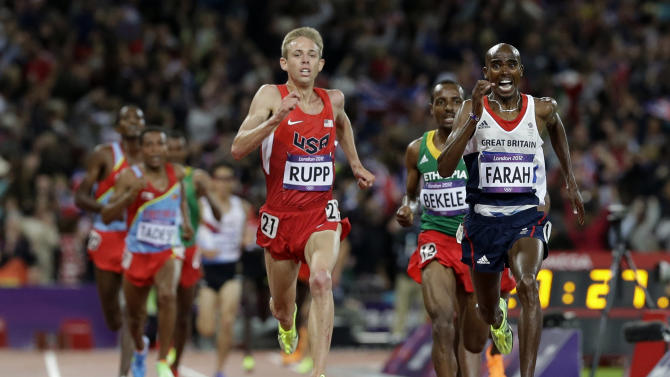 Britain's Mo Farah, right, Ethiopia's Tariku Bekele, center, and United States' Galen Rupp, left, head for the finish line in the men's 10,000-meter final during the athletics in the Olympic Stadium at the 2012 Summer Olympics, London, Saturday, Aug. 4, 2012. (AP Photo/Anja Niedringhaus)