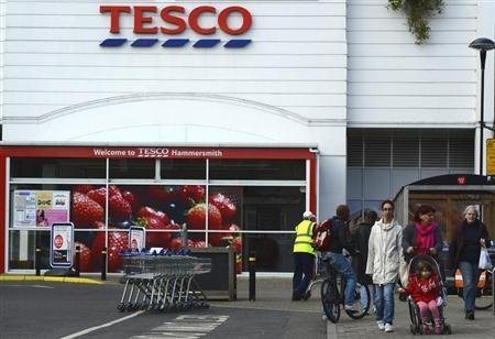 A customer leaves a Tesco store in Hammersmith, west London October 3, 2012. REUTERS/Paul Hackett