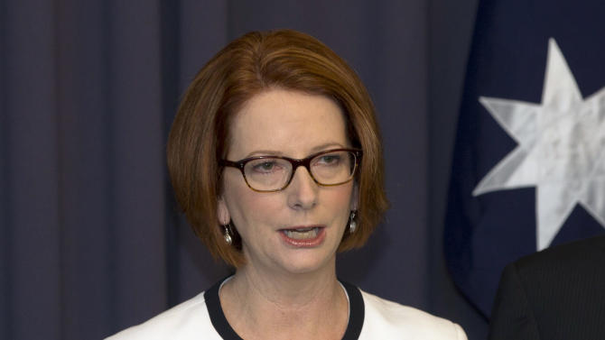 Australia's Prime Minister Julia Gillard makes a statement to the media after a leadership ballot in Canberra, Australia, Thursday, March 21, 2013. Gillard remains Australia's prime minister after she threw her job open to a leadership ballot but no one from the government was willing to run against her.(AP Photo/Rob Griffith)
