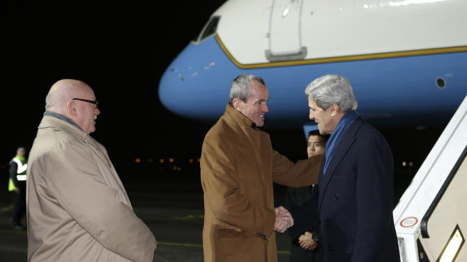 U.S. Secretary of State John Kerry, right, is greeted by US Ambassador to Germany Philip Murphy on arrival at Tegel International Airport in Berlin, with James Melville, Jr., Deputy Chief of Mission, U.S. Embassy Berlin, on Monday, Feb. 25, 2013. Berlin is the second stop in Kerry's first official trip overseas as secretary. (AP Photo/Jacquelyn Martin, Pool)