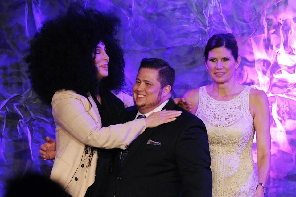 Cher greets her transgender child Chaz Bono (C) as stepmother Mary Bono Mack watches at The 23rd Annual GLAAD Media Awards on April 21, 2012 in Los Angeles, CA. (AP Photo/Vince Bucci)