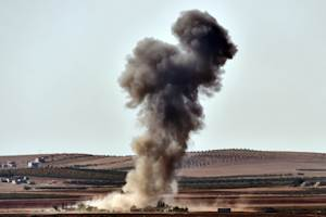 Smoke rises from an airstrike on the outskirts of the…