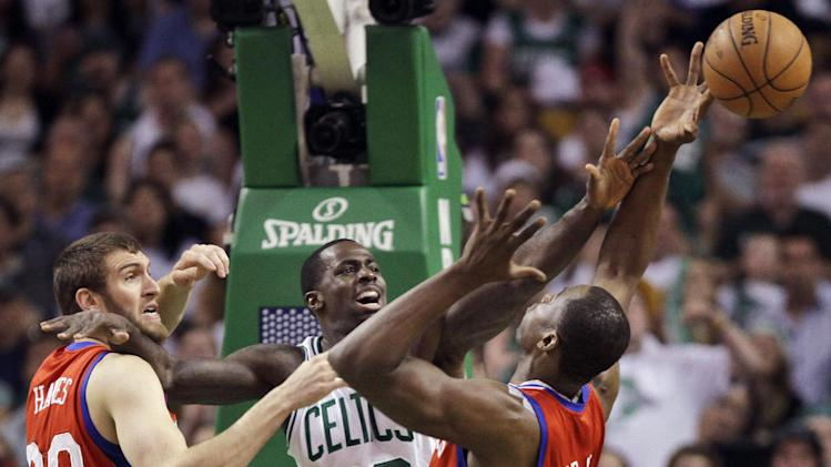 Boston Celtics forward Brandon Bass (30) fights for a rebound with Philadelphia 76ers' Spencer Hawes (00) and forward Elton Brand, right, during the first quarter of Game 7 in an NBA basketball Eastern Conference semifinal playoff series, Saturday, May 26, 2012, in Boston. (AP Photo/Elise Amendola)
