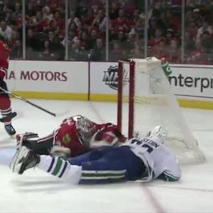 Daniel Sedin scores while falling to ice