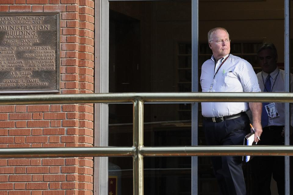 In this photo taken June 12, 2013, Associated Press reporter Michael Graczyk leaves the Huntsville Unit after witnessing the execution of confessed killer Elroy Chester in Huntsville, Texas. Chester was convicted of the 1988 the fatal shooting of Port Arthur firefighter Willie Ryman III. (AP Photo/Pat Sullivan)