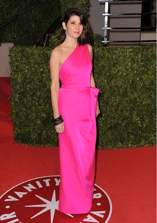 Marisa in a hot pink asymmetrical gown