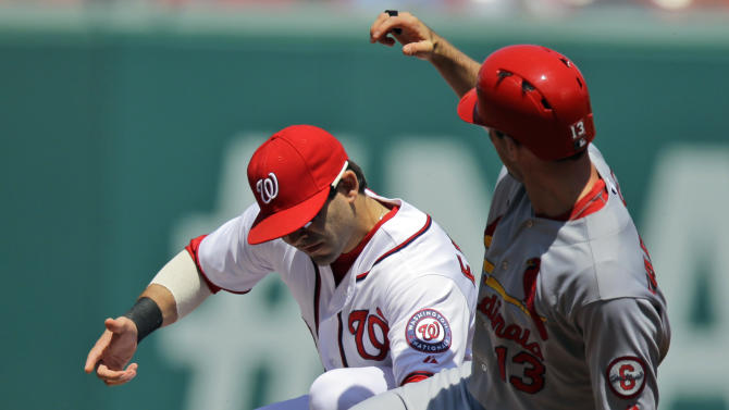 Washington Nationals second baseman Danny Espinosa, left, can't hang onto the ball as St. Louis Cardinals' Matt Carpenter (13) is safe at second with a double during the first inning of a baseball game at Nationals Park, Wednesday, April 24, 2013, in Washington. (AP Photo/Alex Brandon)
