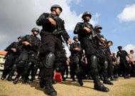 Indonesian police take part in security preparations ahead of the Bali bombings 10th anniversary in Denpasar. Indonesia declared its top security alert Wednesday, citing &quot;credible information&quot; of a threat to a ceremony this week marking the 10th anniversary of the Bali bombings which killed 202 people