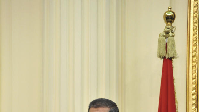 """In this image released by the Egyptian Presidency, Mohammed Morsi addresses the newly convened upper house of parliament in Cairo, Egypt, Saturday, Dec. 29, 2012.  Egypt's Islamist president warned against any unrest that could harm the drive to repair the country's battered economy in his first address before the newly convened upper house of parliament on Saturday, urging the opposition to work with his government. In the nationally televised speech, Mohammed Morsi said the nation's entire efforts should be focused on """"production, work, seriousness and effort,"""" now that a new constitution came into effect this week, blaming protests and violence the last month for causing further damage to an economy already in crisis since the fall of autocrat Hosni Mubarak. (AP Photo/Egyptian Presidency)"""