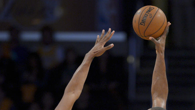 Los Angeles Lakers forward Metta World Peace, right, shoots over San Antonio Spurs forward Kawhi Leonard during the first half in Game 3 of a first-round NBA basketball playoff series, Friday, April 26, 2013, in Los Angeles. (AP Photo/Mark J. Terrill)