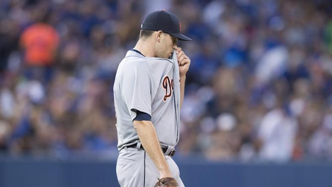 Detroit Tigers starting pitcher Matt Boyd reacts after giving up back-to-back home runs during third-inning baseball game action against the Toronto Blue Jays in Toronto, Friday, Aug. 28, 2015. (Darren Calabrese/The Canadian Press via AP) MANDATORY CREDIT