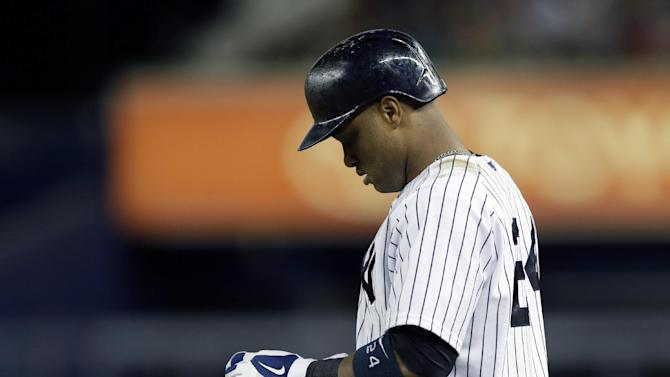 New York Yankees' Robinson Cano (24) reacts after hitting into a third-inning double play in a baseball game against the New York Yankees at Yankee Stadium in New York, Sunday, June 2, 2013.  (AP Photo/Kathy Willens)
