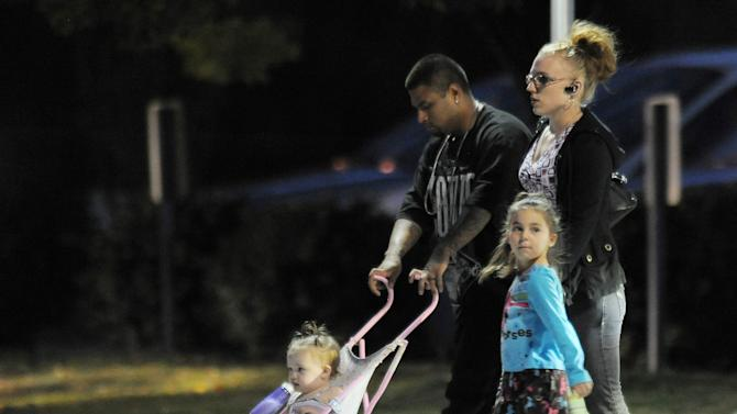 Community members arrive at Faith Bible Chapel to honor the memory of Jessica Ridgeway in Arvada, Colo., on Tuesday, Oct. 16, 2012. More than 2,000 friends, family and community members gathered to remember a 10-year-old Colorado girl who was abducted Oct. 5 on her way to school in suburban Denver. Even as the public memorial was held, multiple agencies were checking leads and asking for more tips in their hunt for Jessica Ridgeway's killer. (AP Photo/Chris Schneider)
