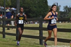 American Heritage cross country runner Daesha Rogers trails in the final mile of the Florida Class 2A state cross country championship race