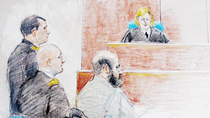 FILE - In this June 11, 2013 file courtroom sketch, U.S. Army Maj. Nidal Hasan, right, is seen sitting by his former defense attorneys Maj. Joseph Marcee, far left, and Lt. Col. Kris Poppe, center, during a hearing at Fort Hood, Texas. The judge, Col. Tara Osborn, has banned the soldier's defense strategy that he shot Fort Hood troops to protect Taliban leaders in Afghanistan. (AP Photo/Brigitte Woosley, File)