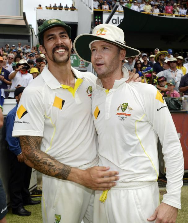 Australia's Mitchell Johnson celebrates with captain Michael Clarke after they won the third Ashes test cricket series against England at the WACA ground in Perth