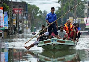 Sri Lankan rescue workers evacuate residents following …