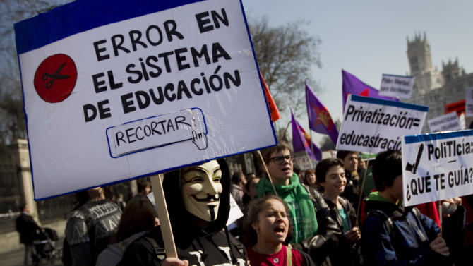 Demonstrators shout slogans and hold banners reading 'Education system fail: cut' as a part of a nationwide day of rallies called to protest against cuts in education spending as Spain endures austerity and the prospect of recession in Madrid, Wednesday, Feb. 29, 2012. (AP Photo/Daniel Ochoa de Olza)