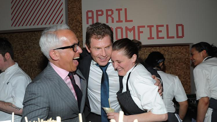 Chefs Bobby Flay, center, and Geoffrey Zakarian, left, share a laugh with Best New Chef alum April Bloomfield at the 2013 FOOD & WINE Best New Chefs 25th anniversary celebration at Pranna in New York, Tuesday, April 2, 2013.   (Photo by Diane Bondareff/Invision for FOOD & WINE/AP Images)