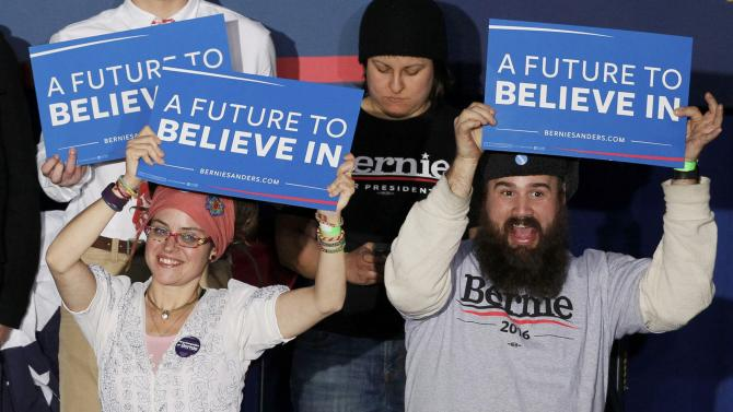 Supporters of Democratic U.S. presidential candidate Bernie Sanders, react at his 2016 New Hampshire presidential primary night rally in Concord