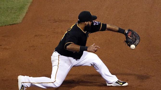 Pittsburgh Pirates first baseman Pedro Alvarez can't backhand a throw from shortstop Jordy Mercer during the sixth inning of a baseball game against the Miami Marlins in Pittsburgh, Tuesday, May 26, 2015. Miami Marlins' Dee Gordon was safe at first on the play.(AP Photo/Gene J. Puskar)