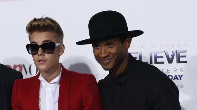 "Bieber and Usher pose at the premiere of the documentary ""Justin Bieber's Believe"" in Los Angeles"
