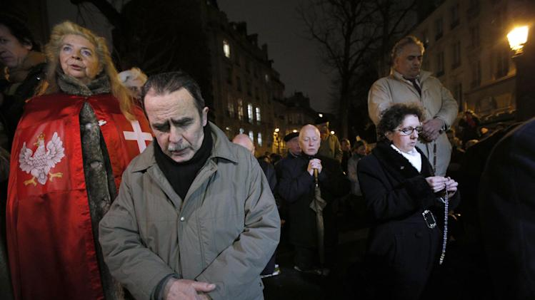 Opponents to gay marriage pray during a demonstration in Paris, Tuesday, Jan. 29, 2013.  The French government has presented a plan for debate in Parliament to legalize gay marriage and adoption. (AP Photo/Christophe Ena)