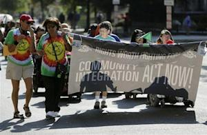 Members of disability rights group supporting Obamacare march in Washington during government shutdown
