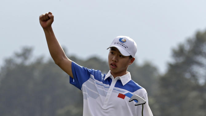 Amateur Guan Tianlang, of China, celebrates after a birdie putt on the 18th green during the first round of the Masters golf tournament Thursday, April 11, 2013, in Augusta, Ga. (AP Photo/Darron Cummings)