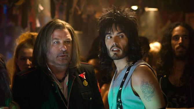 """This film image released by Warner Bros. Pictures shows Alec Baldwin as Dennis Dupree, left, and Russell Brand as Lonny in New Line Cinema's rock musical """"Rock of Ages,"""" a Warner Bros. Pictures release. (AP Photo/Warner Bros. Pictures, David James)"""
