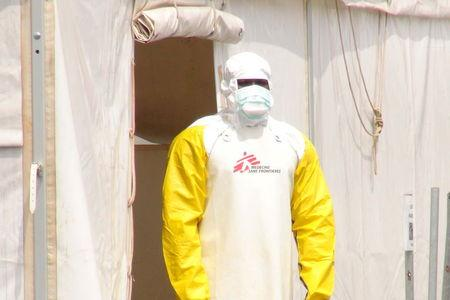 A Doctors Without Borders health worker stands in an Ebola virus treatment center in Conakry