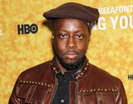 "FILE - In this Oct. 6, 2011 file photo, musician Wyclef Jean poses at the New York Premiere of the HBO Documentary ""Sing Your Song"" about actor Harry Belafonte's life at The Apollo Theater in New York. Jean has written an autobiography, ""Purpose"" which is on sale Tuesday, Sept. 18, 2012. (AP Photo/Starpix, Marion Curtis, file)"