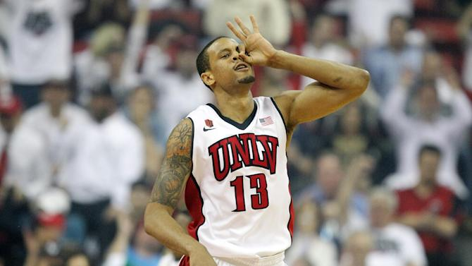 UNLV's Bryce Dejean-Jones reacts after sinking a 3-point shot during the first half of an NCAA college basketball game against San Diego State on Wednesday, March 5, 2014, in Las Vegas. (AP Photo/Isaac Brekken)