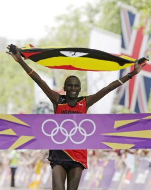 Stephen Kiprotich of Uganda celebrates as he crosses the finish line to win the men's marathon at the 2012 Summer Olympics in London, Sunday, Aug. 12, 2012. (AP Photo/Luca Bruno)