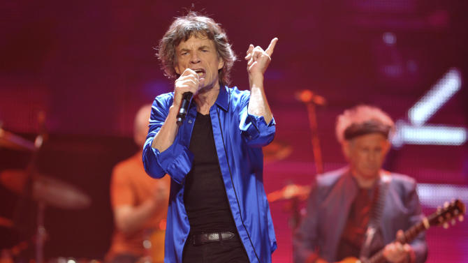 "FILE - In this Saturday, May 18, 2013 file photo, Mick Jagger, left, and Keith Richards, of the Rolling Stones perform on the ""50 & Counting"" tour at the Honda Center, in Anaheim, Calif. Rolling Stones fans know you can't always get what you want. But they may get what they need, with agreement reportedly near between the band and the BBC over televising the Stones' Glastonbury Festival show. Festival organizer Michael Eavis says the BBC will air about an hour of the Stones' live set as part of its extensive TV coverage of the event, it was reported on Friday June 21, 2013. The BBC would not confirm agreement had been reached, saying Friday that it was holding ""extremely constructive and ongoing"" talks with the band. (Photo by John Shearer/Invision/AP, File)"