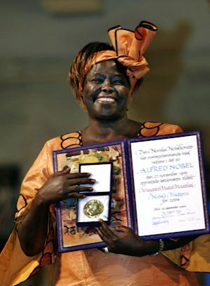 FILE - In this Friday, Dec. 10, 2004 file photo Wangari Maathai from Kenya holds her Nobel Peace Prize in the Oslo City Hall, Norway. Wangari Maathai, the first African woman recipient of the Nobel Peace Prize, died after a long struggle with cancer, the environmental organization she founded said Monday Sept. 26, 2011. She was 71. One of Kenya's most recognizable women, Maathai won her Nobel in 2004 for combining science and social activism. She was the founder of the Green Belt Movement, where over 30 years she mobilized poor women to plant 30 million trees. (AP Photo/ Bjorn Sigurdson, Pool)