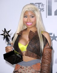 Nicki Minaj poses backstage with the award for best female hip-hop artist at the BET Awards on Sunday, July 1, 2012, in Los Angeles. (Photo by Jordan Strauss/Invision/AP)