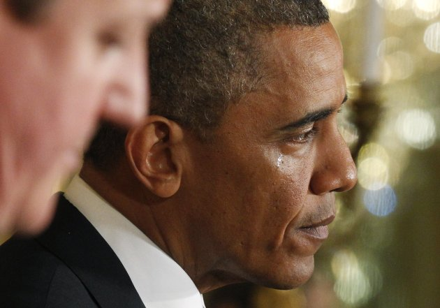 A tear runs down the face of U.S. President Barack Obama as he answers questions about the attack on the U.S. embassy in Benghazi, Libya while Britain's Prime Minister David Cameron listens during a joint news conference in the East Room of the White House in Washington, May 13, 2013. REUTERS/Jim Bourg (UNITED STATES - Tags: POLITICS TPX IMAGES OF THE DAY)
