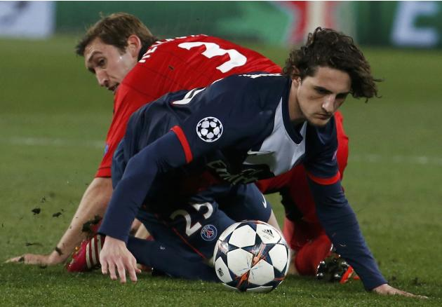 Bayer Leverkusen's Reinartz challenges Paris St Germain's Rabiot during their Champions League round of 16 second leg soccer match at the Parc des Princes Stadium in Paris