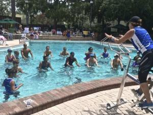 Participants take part in a Hydrorider aqua cycling class at a fitness conference in Tampa Florida