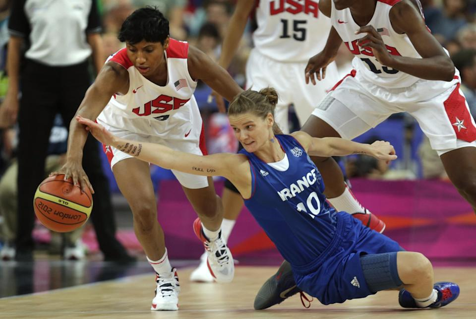 France's Florence Lepron, right, stretches back as United States' Angel McCoughtry steals the ball during the women's gold medal basketball game at the 2012 Summer Olympics, Saturday, Aug. 11, 2012, in London. (AP Photo/Charles Krupa)