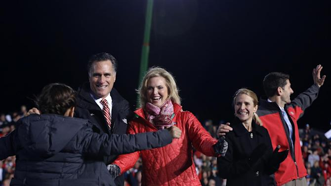 Chloe Romney, granddaughter of Republican presidential candidate, former Massachusetts Gov. Mitt Romney and wife Ann Romney, runs up to the stage for a hug during a campaign stop with Republican vice presidential candidate Rep. Paul Ryan, R-Wis., and his wife Janna Ryan, Friday, Nov. 2, 2012,  at The Square at Union Centre in West Chester, Ohio. (AP Photo/Charles Dharapak)