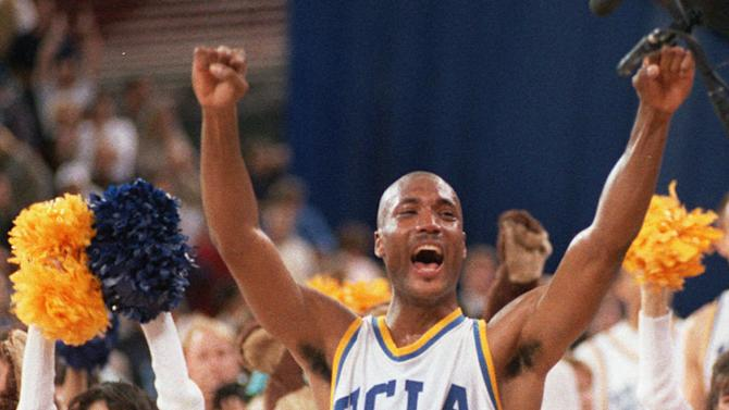 FILE - In this April 3, 1995, file photo, UCLA's Ed O'Bannon celebrates after his team won the NCAA championship game against Arkansas in Seattle. Five years after the former UCLA star filed his antitrust lawsuit against the NCAA, it goes to trial Monday, June 9, 2014, in a California courtroom. (AP Photo/Eric Draper, File)