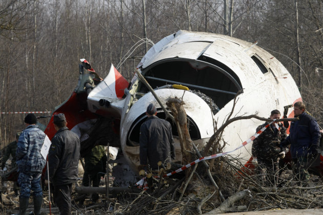 FILE - In this April 14, 2010 file picture emergency ministry workers prepare to load the wreckage of the Polish presidential plane onto a transporter just outside the Smolensk airport, western Russia. Jaroslaw Kaczynski, the twin brother of the Polish president who died in a 2010 plane crash in Russia, said Wednesday March 28, 2012, the accident is looking increasingly like an assassination and called on the European Union to investigate. The plane carrying Lech Kaczynski crashed in heavy fog during an attempted landing at an airport near Smolensk, Russia, on April 10, 2010, killing all 96 people on board. (AP Photo/Mikhail Metzel, File)