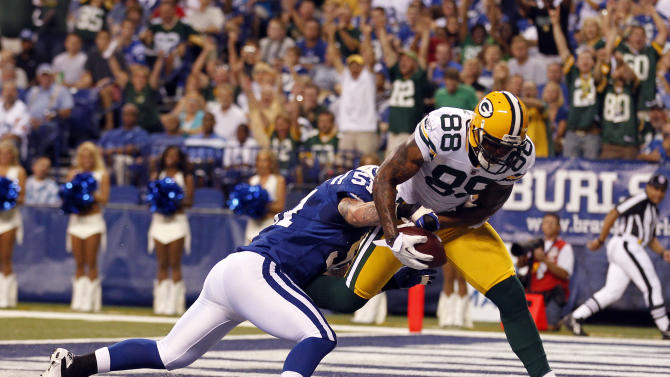 Green Bay Packers tight end Jermichael Finley, right, catches a touchdown pass as he is tackled by Indianapolis Colts linebacker Pat Angerer during the first quarter of an NFL preseason football game in Indianapolis, Friday, Aug. 26, 2011. (AP Photo/AJ Mast)
