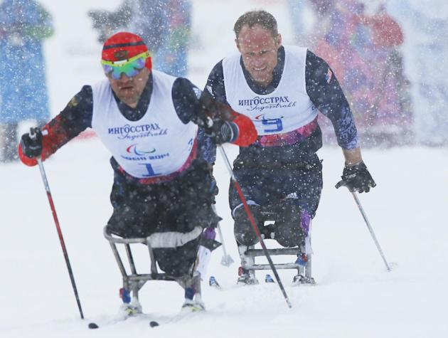 Daniel Cnossen of United States, right and Roman Petushkov of Russia race during the semifinal of the men's cross country 1km sprint, sitting event at the 2014 Winter Paralympic, Wednesday, March