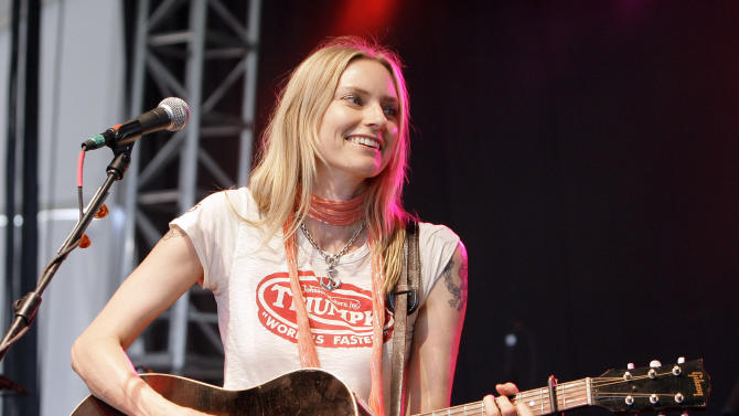 "FILE - This June 15, 2008 file photo shows Aimee Mann at the Bonnaroo music festival in Manchester, Tenn. The musical inspiration for Aimee Mann's latest release, ""Charmer,"" was inspired by ""Jackie Blue,"" a 1975 hit by the Ozark Mountain Daredevils. (AP Photo/Mark Humphrey, file)"