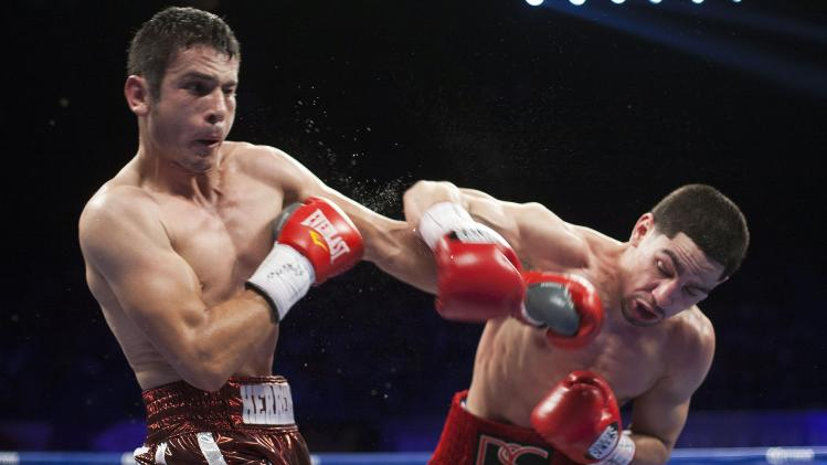 WBC unified super lightweight champion Danny Garcia of the U.S. blocks a punch from Mauricio Herrera of the U.S. in the second round of their championship fight in Bayamon